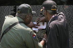 Two Vietnam vets find the name of a fallen comrade on the Moving War