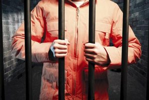Image of a man behind bars.