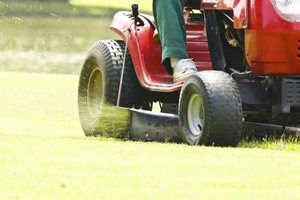 Close-up of man riding on lawn mower