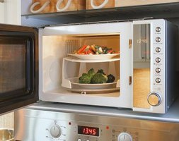 Keeping food covered helps limit microwave spatters.