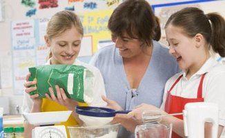 A teacher and her students in home economics class.