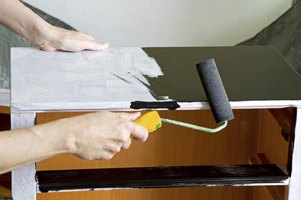 Use a brush or roller to repaint the dresser.
