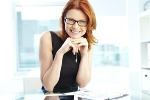 Smiling productive woman in office