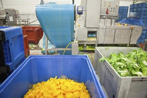 Machines and produce bins in a food processing factory.
