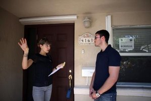 A realtor walking a buyer through a home.