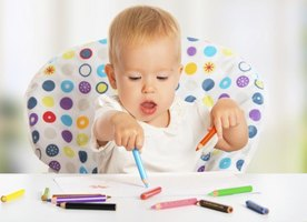 Infant coloring with pencils