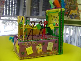 This shoebox parade float is made with felt, pipe cleaners, glue and embellishments.