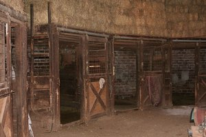 Interior of a round barn used for housing horses.