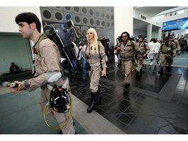 Ghostbusters wear protective overalls and have a proton pack.