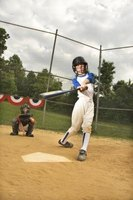 Teach a youngster how to compete at the plate in a softball game.