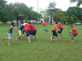 A standard run play takes place during a flag football game.