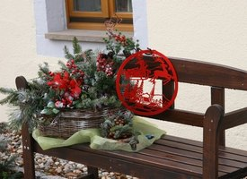 Create a festive Christmas-themed front porch with lights and other decorations.