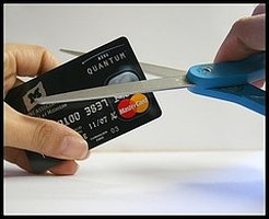 Getting control of your credit may start with a pair of scissors.