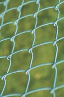 Chain-link fences come in several colors and materials.