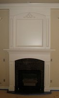 Enhance a dull-looking fireplace by installing a fireplace mantel.