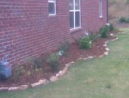 This Rock Border Adds an Elegant Line Denoting the Garden Area in this Yard..