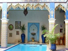 A Moroccan courtyard and pool, with traditional tile inlay.