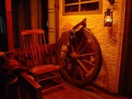 Rustic lantern with saddle, wheel and rocker