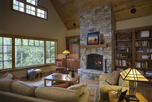 A stone fireplace with rounded hearth.