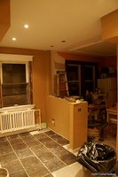 Kitchen renovations are made to include a half wall.
