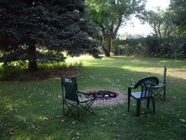 Landscape around your backyard firepit with brick, rocks or patio stones for a finished look.