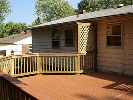 Decks add outdoor living space and increase home value.