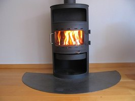 Stovepipe installation is easier when a wood stove is placed near a wall.