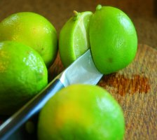 The natural bleaching properties of limes make them effective at lightening dark spots.