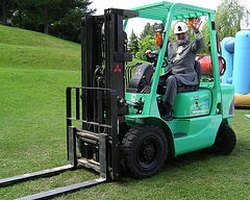 Driving a forklift.
