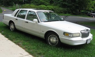 Locate or replace the starter motor on your Lincoln Town Car