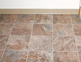 Vinyl tile can cover particle board.