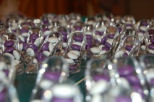 Glass slippers filled with candy complement a Cinderella wedding theme.