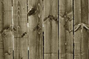 a wooden panel fence is a solid barrier that puts a lot of stress on fence