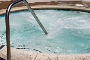 Use a tarp to speed up the water-changing process in hot tubs.