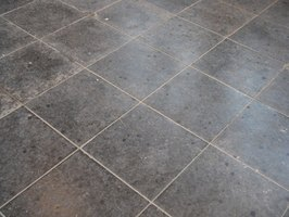 Take a decorative approach when transitioning from one tile floor to another.
