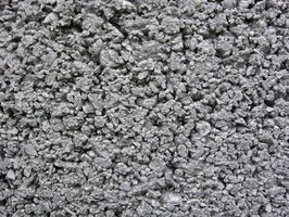 Chipped concrete indicates spalling damage