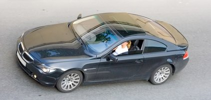 Replace the battery in a BMW 325xi by accessing the trunk.
