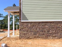 Houses can be covered entirely with vinyl siding or partial siding and stone or brick