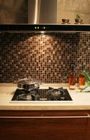 A kitchen backsplash is an easy-to-clean surface.