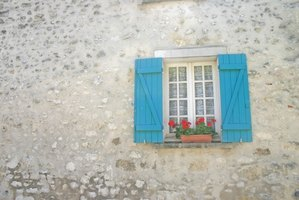 Window shutters help add to the ambiance of the French country cottage look.