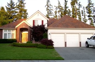 Attached garages take their roof cue from the home.