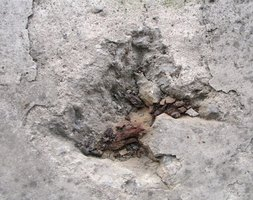 Deep holes in cement require extra attention to repair.