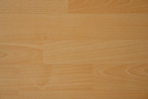Laminate flooring may be installed over concrete.