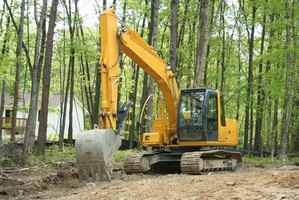 An excavator can cut your time in half when removing a stump.
