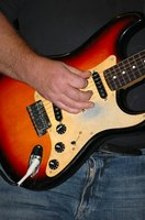 Using heavy gauge strings will help your guitar sound more like a bass.