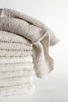 Wash white towels with bleach to keep them clean.