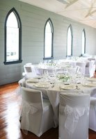Homemade chair covers add elegance to a wedding reception.