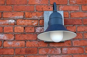 Mount exterior lights on your house using a mounting block.