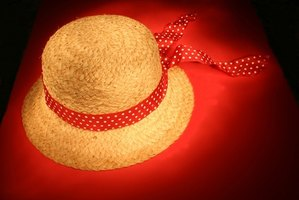 Embellish a straw hat with decorative fabric.