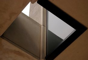 Cut a hole in the roof to install a skylight.